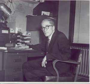 Dr. Martin sitting at his desk.